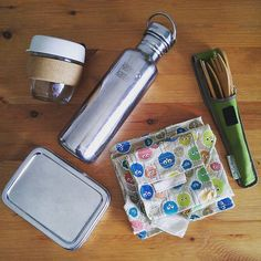 The contents of a 21st Century handbag  A stainless steel water bottle, cloth wraps, a stainless steel lunchbox, reusable cutlery, a reusable coffee cup and a metal straw. Because I'd hate to be caught out unprepared! These are what I deem to be the important things...oh, and my wallet!