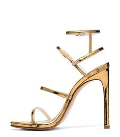 A soon-to-be staple for the stylish celebrity set, this showstopping stiletto has already been spotted on and off the red carpet. From its single-sole silhouette to its slim, metallic straps that extend beyond the ankle, this sexy sandal will turn heads, especially when worn with evening separates and topped off with a box clutch.