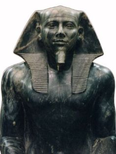 The Valley Temple, Egypt:  This diorite sculpture was found upside down, buried and broken in a shaft (#16) in this temple. It is believed to represent the pharaoh Khafre. The divine falcon Horus, son of Osiris and Isis, guardian deity of the pharaohs, is seated behind the figure's head.