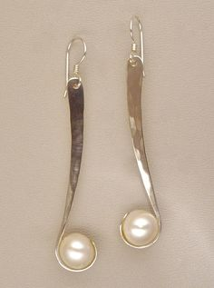 Custom Made 'Wrapture' Earrings Very elegant, graceful forged shape and pearl setting. Wish the top echoed the wrap at the bottom, instead of a just a hole with a jump ring. Design idea: synclast/anticlast?