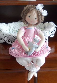 This is Candy and her Teddy. She is a decorative fibre art doll handmade with love and care by me. Approx. 35 cm in length, with alpaca wool
