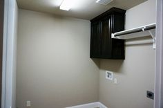Utility room, cabinet with hanging rod #mcbeehomes