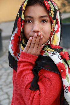 syrian girl with red Photo by MERVE ATES -- National Geographic Your Shot