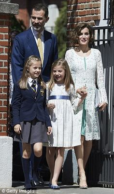King Felipe and Queen Letizia are shown at the First Communion of their daughter, Infanta Leonor (in blue school outfit) with their younger daughter, Infanta Sofia.