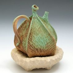 Green, tan & brown carved porcelain pod teapot with yellow pillow