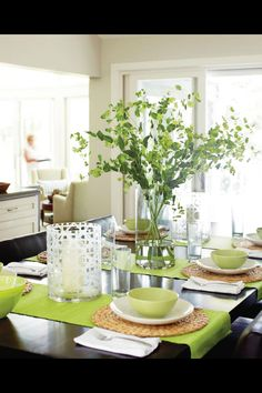 green and white with rattan table setting
