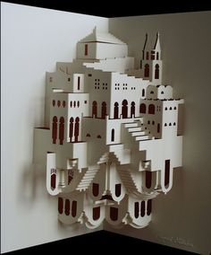 Paper sculpture made from a single sheet of paper by Danish artist Ingrid Siliakus