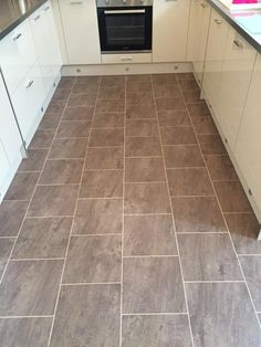 SL Design Floor, Colonia Quarried Millstone with Maple marquetry strips