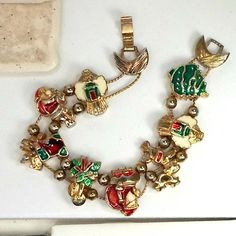 Bracelet Christmas slide charms Santa angel tree size 7 1/4  Santa slide bracelet vtg 2 hole 2 chain angel tree Santa reindeer size7 1/4 heavy  This bracelet is size 7 1/4 on the bracelet mandrel - it