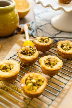 Baklava Cookie Cups from The Girl In The Little Red Kitchen | Honey cookies are packed with pistachios and a spiced honey syrup for a delicious take on traditional baklava.