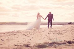 Bride and groom on Dorset beach for sunset at seaside theme wedding photographs. Photography by one thousand words wedding photographers