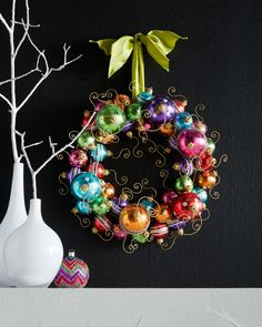 """Holiday Ball Wreath Retro styling gives this colorful ornament wreath a bit of mid-century flair. •Handcrafted of plastic and metal. •17""""Dia. x 5.5""""D."""