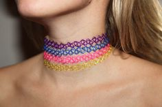 remember these? why not play it up, find yourself a white choker, and add crystals to it.?