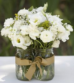 Clustered mason jars tied with ribbon.