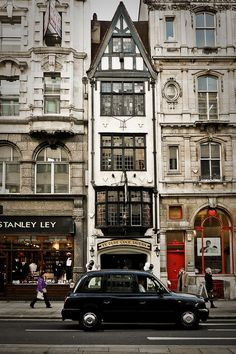 enchantedengland: This is Fleet Street in London; and you cannot miss Fleet Street, should you be fortunate enough to find yourself frolicking and capering about London. Ye Olde Cock Tavern was...