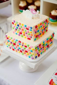 rainbow birthday party color me happy candy frosting cake