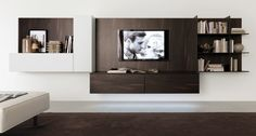 Wall-mounted wooden storage wall Monopoli Collection by Zalf Wall Unit Designs, Tv Wall Design, House Design, Sophisticated Bedroom, Elegant Sophisticated, Wall Storage Systems, Tv Wand, Teal Walls, Wall Mounted Tv