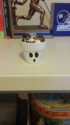 Halloween D.I.Y.  Ghost terracotta pot with painted acorns