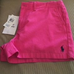 Pink rl shorts in size 6 Women's ralph lauren shorts with logo in front, fake pockets, and are new with tag. Ralph Lauren Other