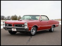 66 Pontiac GTO Convertible  My DREAM CAR.... 389   4 - speed 4 on the floor  3 duces  Factory Original - desired.... Just one beautiful machine!!!!!!!