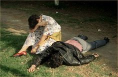 ENRIQUE METINIDES:A Woman Grieves over Her Dead Boyfriend, Stabbed in Chapultepec Park While Resisting Robbers, Mexico City, 1985