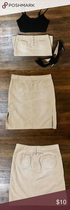 """A/X Armani Exchange Skirt, size 2 Excellent condition! Light tan colored Corduroy that is perfect for fall! Measurements lying flat: 14.5"""" waist, 20"""" waist to hem and 8.5"""" from the hem up to the tops of the two slits in the front! Ships same or next day from smoke free home. A/X Armani Exchange Skirts Mini"""