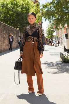 Pin for Later: 14 Street Style Fashion Hacks to Try Right Now Wear a Skirt Over Pants