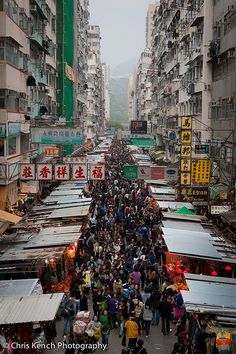 'Mong Kok with its eclectic mix of speciality markets is your best bet for a rewarding sprawl crawl. The Tung Choi St Market/ Ladies' Market has a mile-long wardrobe of clothes which range from 'I Love HK' tees and football jers Hong Kong, Places Around The World, Around The Worlds, Ladies Market, Macao, Shenzhen, Street Photography, Places To See, Scenery