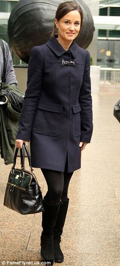 The author chose a smart wool navy coat which she teamed with a mock croc bag and suede knee-high boots