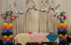 Carebear theme and name balloon arch by Events hy Car'Lisa