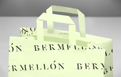 Paper bag for confectionery shop Bermellón designed by Anagrama