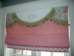 Functioning roman shade with decorative, embroidered valance.