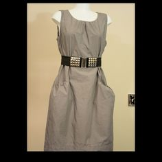 Gray sleeveless Shift Dress with Front Pockets Looking for an easy to style shift dress? This is an excellent pick. Front pockets lend ease to stashing items and a nice detail, while the modest neckline makes this very versatile. Dress only, belt not included. Fun and edgy with a studded belt, moto jacket, and boots. Or head to a meeting, with a belted cardigan and heels. In excellent used condition. Mossimo brand. Mossimo Supply Co. Dresses Midi