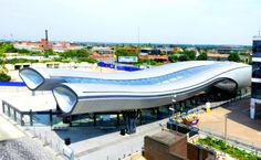 The new Slough Bus Station improves pedestrian access for the city center and boasts a BREEAM 'Very Good' rating with energy efficient design. Bus Shelters, Bus Terminal, Eco Architecture, Bus Station, Bus Stop, Pedestrian, Green Building, Sustainable Design, Public Transport