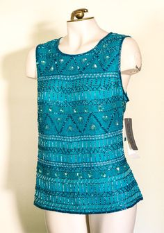Teal beaded and sequined sleeveless top by by TimeTravelFashions