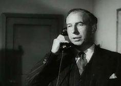 0 Russell Napier on the phone in the man in the road 1956