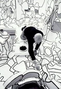 Jean Dubuffet (1901 - 1985) working in his studio