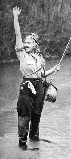 The lovely Joan Blondell poses for a photo while fishing ca. 1935.