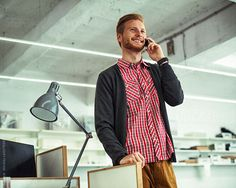 Smiling Businessman Making a Phone Call by Lumina