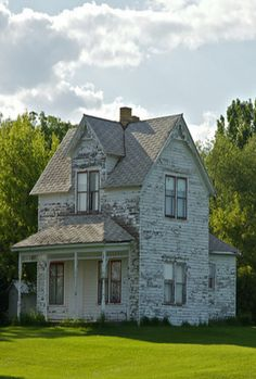 old farmhouse must have tall ceilings inside , notice the gap between windows and roof.