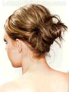Love this!   How To Style: 1.Add backcombing to dried hair in the top/crown area. Also pop a little in the back around where you're pinning your bun to help hold the pins.  2.Part hair on one side and smooth hair back to just below the middle of the back of your head and secure with a hair binder. 3.Twist ends of your pony up in 3 separate sections, one at a time, and pin randomly underneath. 4.Spray finished style with firm hold hairspray.