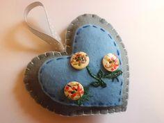 Handmade felt heart in grey with flower details by Madeinthehoose