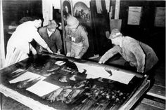 Monuments Man George Stout moves the central panel of the Ghent Altarpiece in Altaussee, Austria in July of 1945. AP Photo/National Archives and Records Administration.