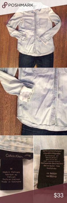 Calvin Klein Sun-Bleached Chambray This pale chambray is soft and versatile. Dress it up or down. It's got white flannel lining the cuffs (shown in the second picture) and the top of the back of the shirt. In good used condition. Make me an offer. Calvin Klein Jeans Tops Button Down Shirts