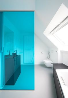 Coloured Bathroom Divider Adds A Statement To A Minimalist White Bathrooom