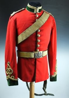 Victorian 5th (Princess Charlotte of Wales's) Dragoon Guards Officer's Uniform. The small sized 1880 pattern full dress tunic is externally stunning, constructed of scarlet melton cloth with beautiful dark bottle green facings of velvet. Gold cord Austrian Knot details to the cuff as well as further cord decoration to the tails and gold lace to the stand up collar. Very fine gold bullion epaulettes to the rank of Second Lieutenant