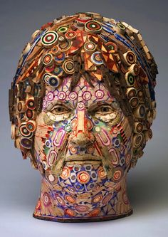 Artist Michael Ferris Jr. turns recycled  wood and pigmented grout into complex portrait sculptures.