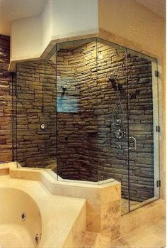 This handsome shower is covered in natural stone.