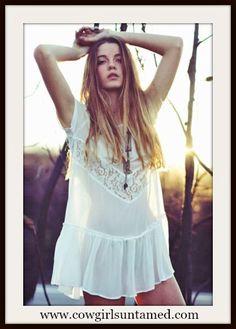LAST ONE!!!!  www.cowgirlsuntamed.com #boho #gypsy #cowgirl #lace #top #tunic #minidress #sexy #white #semisheer #boutique #fashion #beautiful #onlineshopping #bikinicoverup