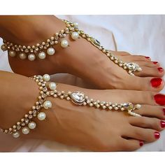 Diamanté Kundan Anklet with Toe Ring. These Barefoot Sandals are Draped with Pearls and Rhinestones. Beautiful Gold Bridal Foot Jewelry Beaded with Pearls are Perfect for a Wedding on the Beach. This BareFoot Sandal Design will Compliment the Bride or her Bridesmaids. Add the Finishing Touches with these Elegant Beaded Bare Sandals with Silver or Gold Ankle Chains. Adjustable at the Back of the Foot.